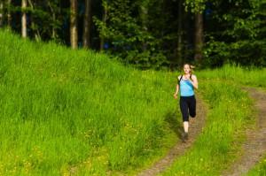 Caucasian woman running on path